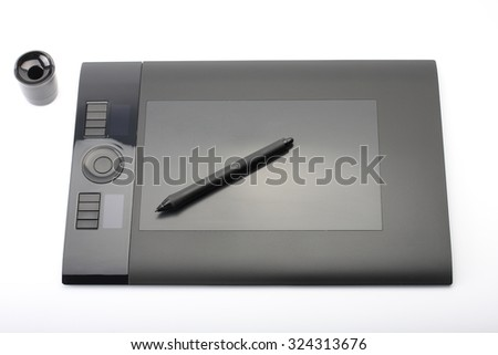 graphic tablet and pen and stand for nibs on white background