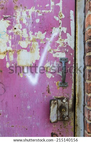 Graphiti on an abandoned door in a city environment - stock photo