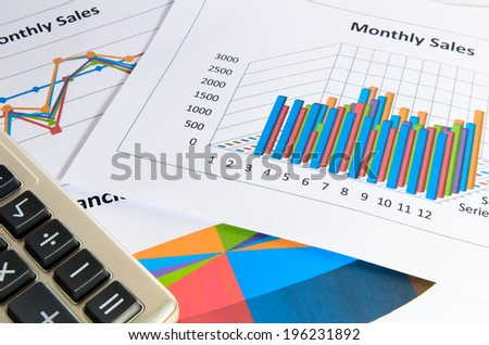 Graphs and charts of Monthly sales report with calculator - stock photo