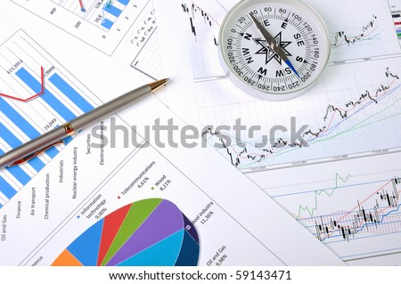 Graphs and charts. Workplace businessman.