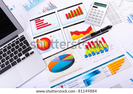 Graphs, charts, business table. The workplace of business people. - stock photo