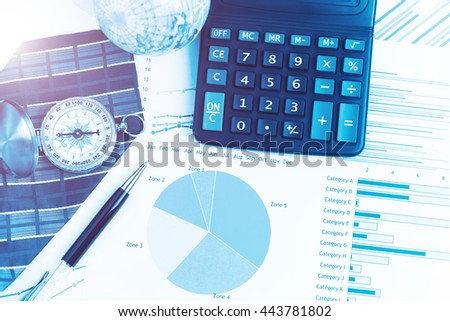 Graphs, charts, calculator, pen, compass on business table. The workplace of business people. Blue color tone. - stock photo