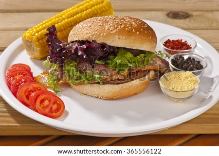 Grass Fed Bison Hamburger with Lettuce - stock photo