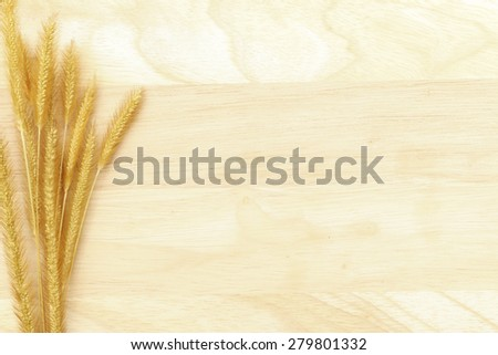 Grass flowers decorate on wood background for background presentation.