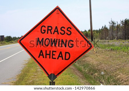 Grass mowing sign