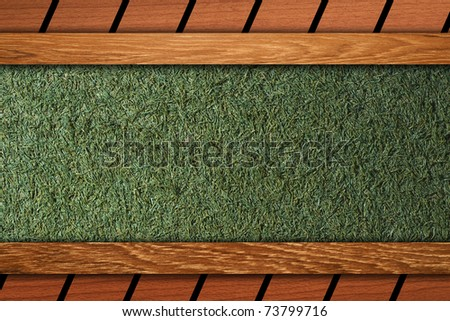 Grass on wood board background