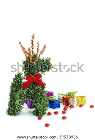GRASS REINDEER WITH RIBBON, GIFT AND LOVE BEAN ON WHITE BACKGROUND
