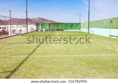 Grass tennis court in the nursery school. - stock photo