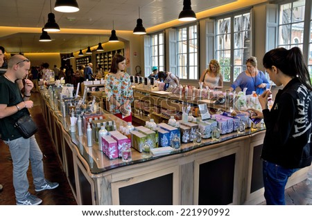 GRASSE, FRANCE - JUNE 2, 2014: Perfume Shop inside Fragonard factory. People choose and buy perfume. Fragonard perfumery is one of the older factory in the world capital of perfumes.  - stock photo