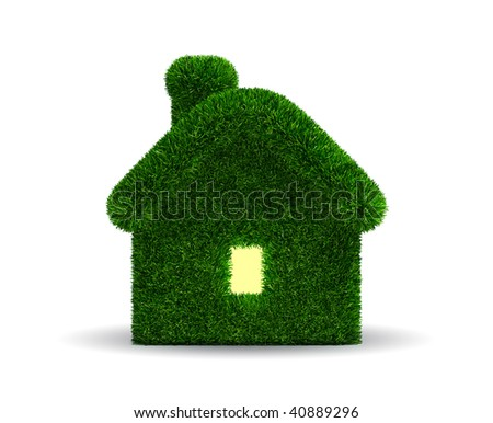 Grassed house which light in window - stock photo