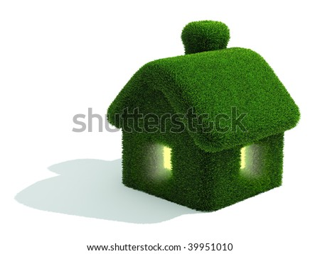 Grassed house which lights in windows - stock photo