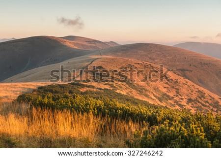 Grassy mountain ridge at amazing sunrise light - Greater Fatra National Park, Slovakia, Europe - stock photo