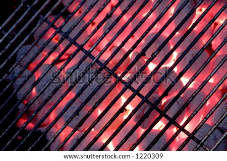 grate on charcoal grill with flames - stock photo