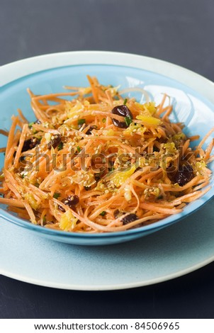Grated carrot salad with raisins and sesame seeds
