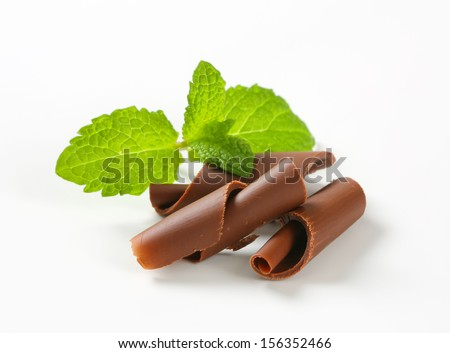 grated chocolate curls with mint - stock photo