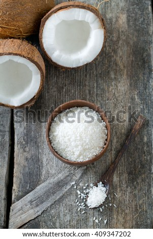 grated coconut on wooden surface - stock photo