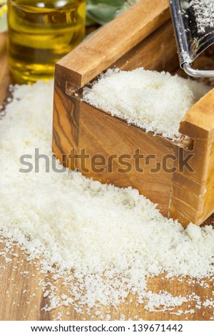 Grated Parmesan cheese.Close up, shallow DoF - stock photo