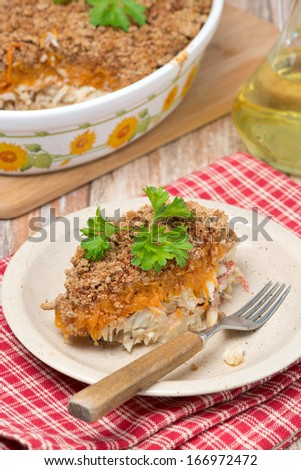 Gratin with fish and pumpkin on the plate, vertical