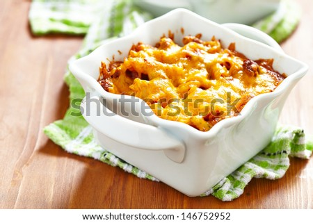 Gratin with macaroni, meat, cheese and tomato sauce - stock photo