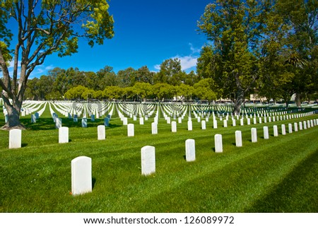 Grave stone head markers lie in patterns across the grounds of the Los Angeles National Cemetery. - stock photo