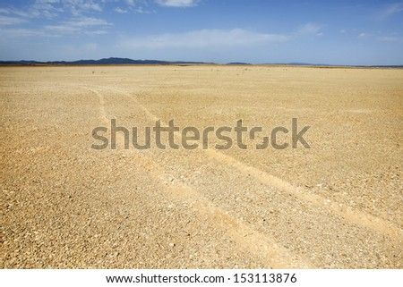 gravel desert tire marks - stock photo