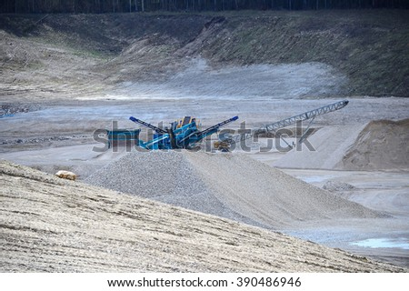 Gravel Pit Machine working in a dusty Gravel Pit - stock photo