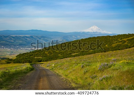 Gravel road and view of Mount Hood, Eastern Washington - stock photo