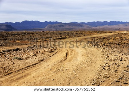 Gravel road in Middle Atlas Mountains, Morocco, Africa - stock photo