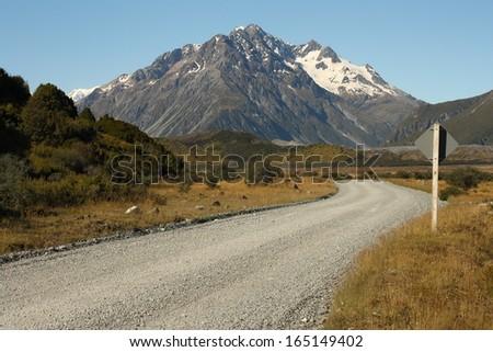 gravel road to Tasman Lake in Mount Cook National Park - stock photo