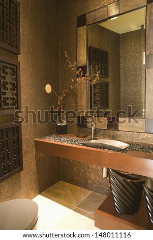 Gravel topped washbasin in bathroom