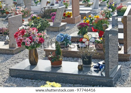 graves  headstones and crucifixes of a cemetery in Italy - stock photo