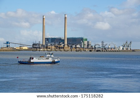 GRAVESEND, KENT, UK - FEB 4, 2014:  The Gravesend - Tilbury Ferry, Duchess M, sailing towards Gravesend.  In the background is the Tilbury Power Station which ceased operation in October 2013. - stock photo
