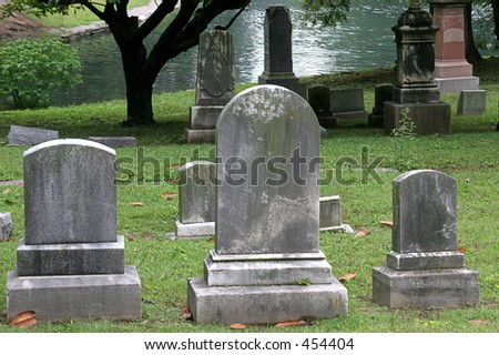 gravestones beside a lake in historic Cave Hill Cemetery - stock photo