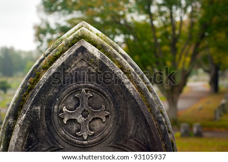 Gravestones in an old cemetery during autumn. - stock photo