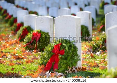 Gravestones with Christmas wreaths in Arlington National Cemetery - Washington DC United States  - stock photo
