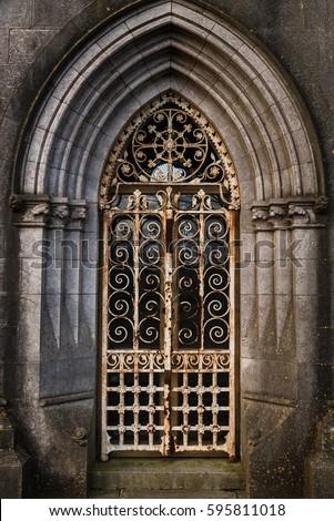 Graveyard tomb door Rusty locked gate archway & Graveyard Tomb Door Rusty Locked Gate Stock Photo (Royalty Free ...