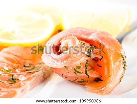 gravlax slices with lemon on white - stock photo