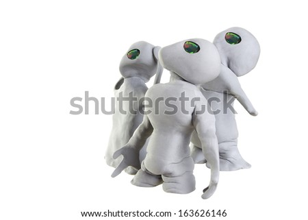 gray alien made of clay on a white background - stock photo