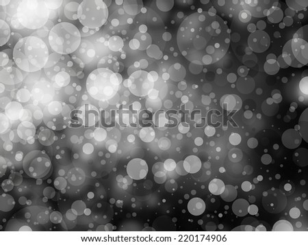 gray black and white bokeh background. Shimmering white Christmas lights or abstract falling snow. Festive party background. Fantasy night or magical background glitter sparkles  - stock photo