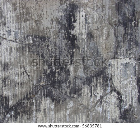 gray black beige very dirty worn stone cut wall with cracks - stock photo
