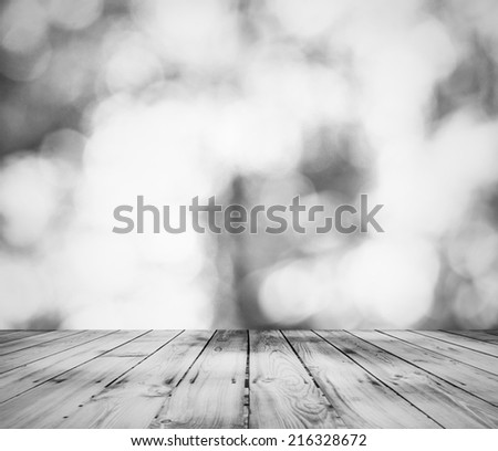 gray bokeh and wooden floor background - stock photo