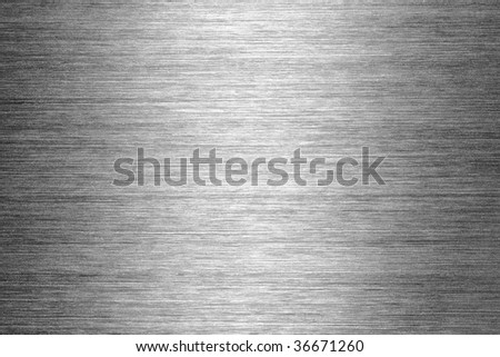 gray brushed metal texture in background - stock photo