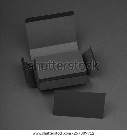 Gray business cards in the gray box - stock photo
