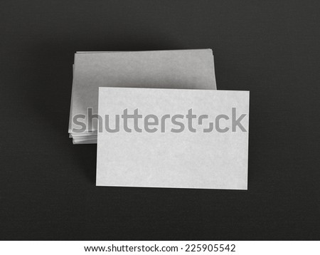 Gray business cards on textile background - stock photo