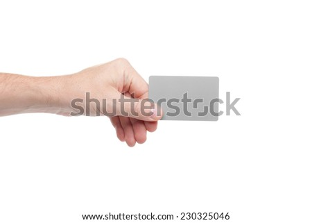 gray card in a human hand isolated on white background - stock photo