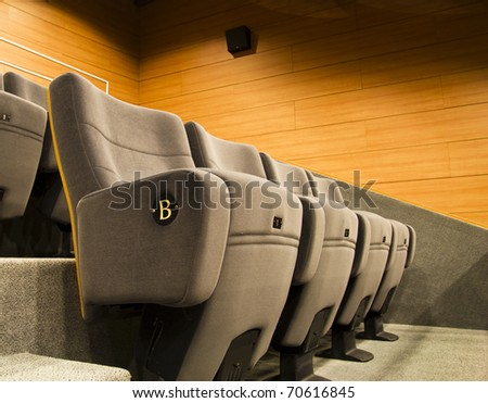 gray chair of a cinema or theater - stock photo