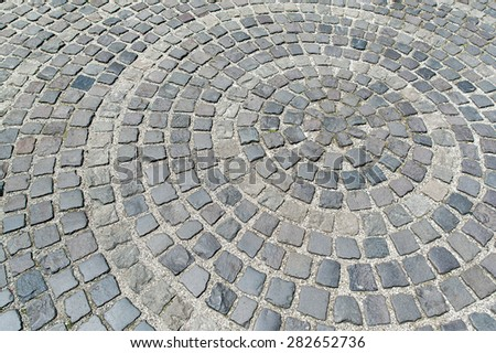 Gray circle cobblestone pavement city street floor texture as background image