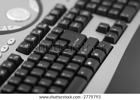 Gray computer keyboard with multimedia extra buttons focused on Enter.