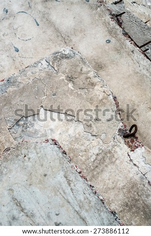 Gray concrete blocks with metal loops and rich texture, Close up. - stock photo