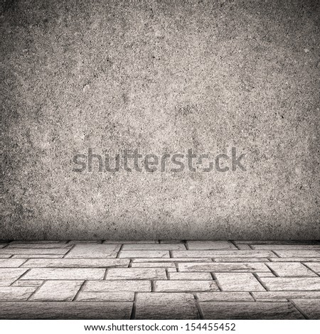 Gray concrete wall and brick floor interior background  - stock photo